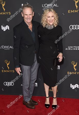 "Bo Welch, Catherine O'Hara. Catherine O'Hara, Emmy nominee for ""Schitt's Creek,"" right, and Bo Welch arrive at the 2019 Performers Nominee Reception hosted by the Television Academy at the Wallis Annenberg Center for the Performing Arts, in Beverly Hills, Calif"