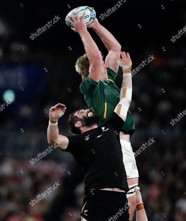 South Africa's Eben Etzebeth leaps above New Zealand's Samuel Whitelock to win a lineout during the Rugby World Cup Pool B game at International Stadium between New Zealand and South Africa in Yokohama, Japan