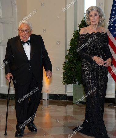 Former United States Secretary of State Henry Kissinger and Nancy Kissinger arrive at the White House