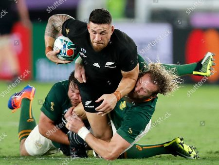 Sonny Bill Williams of New Zealand is tackled by RG Snyman (R) and Frans Malherbe of South Africa during the Rugby World Cup 2019 between New Zealand and South Africa in Yokohama, south of Tokyo, Japan, 21 September 2019.