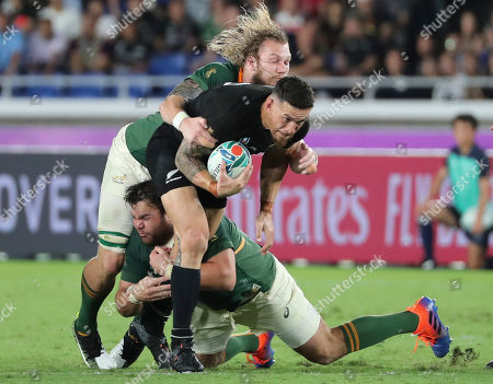 Stock Photo of New Zealand's Sonny Bill Williams, center, is tackled during their match against South Africa at the Rugby World Cup Pool B game in Yokohama, Japan