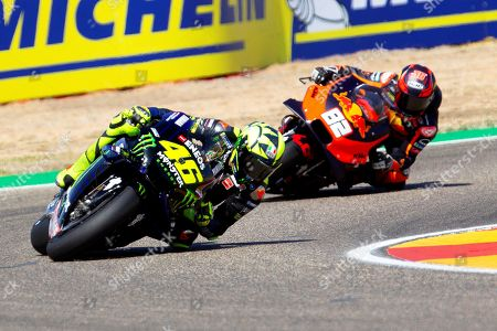 Italian MotoGP rider Valentino Rossi (L) of the Monster Energy Yamaha MotoGP team in action during the qualifying session at Motorland circuit in Alcaniz, Spain, 21 September 2019. The Motorcycling Grand Prix of Aragon will be held on 22 September 2019.