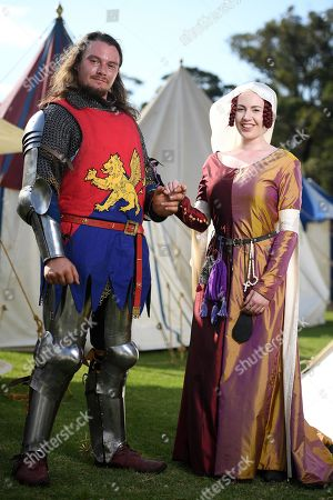 Stock Picture of Richard Sheffield and Charlotte Rose pose for a photograph during the traditional St Ives Medieval Faire at the St Ives Showground in Sydney, 21 September 2019. Every year in September the area is turned into a medieval village with brave knights crossing their lances in grand tournaments, musicians playing their drums and pipes or vedors and craftsmen offering their goods in open market stalls.