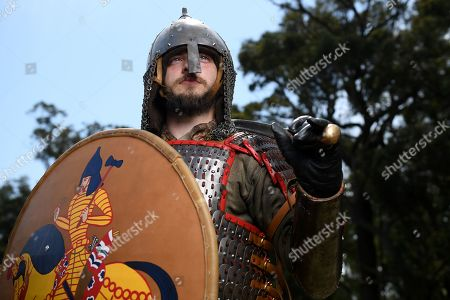 8th Century Khazar reenactor Ben Smith poses for a photograph during the traditional St Ives Medieval Faire at the St Ives Showground in Sydney, 21 September 2019. Every year in September the area is turned into a medieval village with brave knights crossing their lances in grand tournaments, musicians playing their drums and pipes or vedors and craftsmen offering their goods in open market stalls.