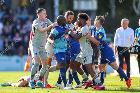 A scuffle breaks out over the foul to Portsmouth midfielder Tom Naylor (4) during the EFL Sky Bet League 1 match between Wycombe Wanderers and Portsmouth at Adams Park, High Wycombe
