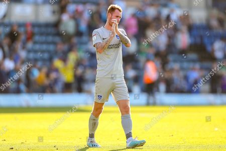 Portsmouth midfielder Tom Naylor (4) thanks the travelling fans during the EFL Sky Bet League 1 match between Wycombe Wanderers and Portsmouth at Adams Park, High Wycombe