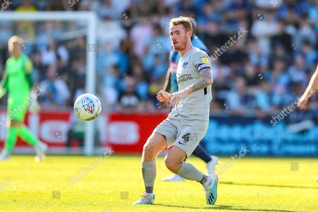 Portsmouth midfielder Tom Naylor (4) during the EFL Sky Bet League 1 match between Wycombe Wanderers and Portsmouth at Adams Park, High Wycombe