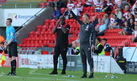 Peterborough United Manager Darren Ferguson alongside Doncaster Rovers manager Darren Moore