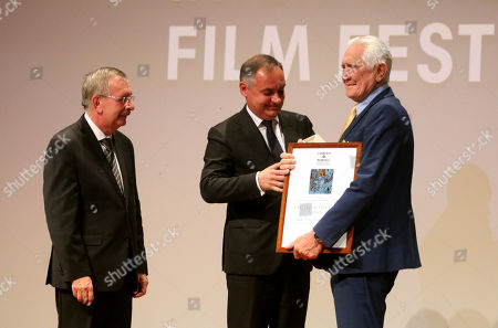 George Lazenby (R) is being awarded with the Lifetime Achievement Award of the 16th CineFest Miskolc International Film Festival by deputy major Janos Kiss (C) and festival director Tibor Biro in Miskolc, Hungary, 20 September 2019. The festival runs from 13 to 21 September.