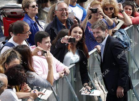 Antonio de la Torre poses with a fan at the 67th edition of the San Sebastian International Film Festival, in San Sebastian, Spain, 22 September 2019. The festival runs from 20 to 28 September.