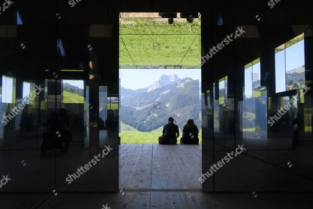 Stock Photo of People visit the installation 'Mirage Gstaad' by American artist Doug Aitken, in Gstaad, Switzerland, 21 September 2019. The structure is presented during the exhibition 'Elevation 1049: Frequencies' that will be visible until spring 2021.