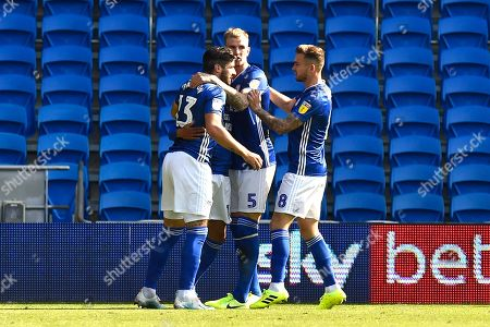 Goal - Callum Paterson (13) of Cardiff City celebrates with Aden Flint (5) of Cardiff City and Joe Ralls (8) of Cardiff City after the Ashley Fletcher (11) of Middlesbrough own goal gave Cardiff a 1-0 lead during the EFL Sky Bet Championship match between Cardiff City and Middlesbrough at the Cardiff City Stadium, Cardiff