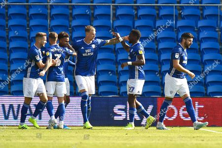 Goal - Aden Flint (5) of Cardiff City and Omar Bogle (27) of Cardiff City celebrate after the Ashley Fletcher (11) of Middlesbrough own goal gave Cardiff a 1-0 lead during the EFL Sky Bet Championship match between Cardiff City and Middlesbrough at the Cardiff City Stadium, Cardiff