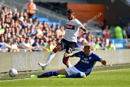 Ashley Fletcher (11) of Middlesbrough is tackled by Aden Flint (5) of Cardiff City during the EFL Sky Bet Championship match between Cardiff City and Middlesbrough at the Cardiff City Stadium, Cardiff