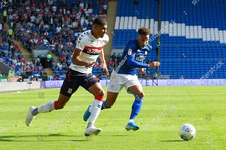 Ashley Fletcher (11) of Middlesbrough on the attack chased by Josh Murphy (11) of Cardiff City during the EFL Sky Bet Championship match between Cardiff City and Middlesbrough at the Cardiff City Stadium, Cardiff
