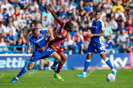 Gillingham FC defender Barry Fuller (12) and Ipswich Town defender Kane Vincent-Young (24) during the EFL Sky Bet League 1 match between Gillingham and Ipswich Town at the MEMS Priestfield Stadium, Gillingham