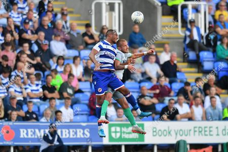 Blackburn Rovers midfielder Lewis Holtby (22) and Reading defender Jordan Obita (11) during the EFL Sky Bet Championship match between Reading and Blackburn Rovers at the Madejski Stadium, Reading