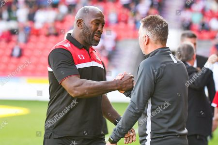 Darren Moore of Doncaster Rovers (Manager) greets Darren Ferguson of Peterborough United (Manager) during the EFL Sky Bet League 1 match between Doncaster Rovers and Peterborough United at the Keepmoat Stadium, Doncaster