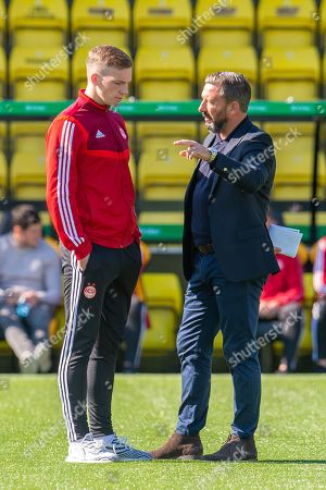Aberdeen manager Derek McInnes speaks with Lewis Ferguson (#19) of Aberdeen FC before the Ladbrokes Scottish Premiership match between Livingston FC and Aberdeen FC at The Tony Macaroni Arena, Livingston