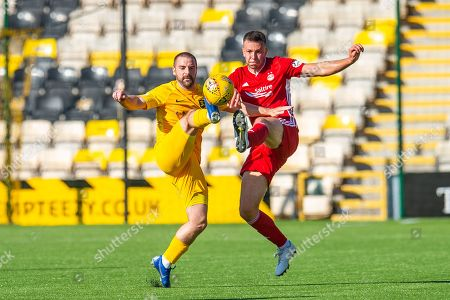 Scott Robinson (#17) of Livingston FC and Andy Considine (#4) of Aberdeen FC challenge for the ball during the Ladbrokes Scottish Premiership match between Livingston FC and Aberdeen FC at The Tony Macaroni Arena, Livingston