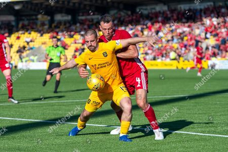Scott Robinson (#17) of Livingston FC shields the ball from Andy Considine (#4) of Aberdeen FC during the Ladbrokes Scottish Premiership match between Livingston FC and Aberdeen FC at The Tony Macaroni Arena, Livingston