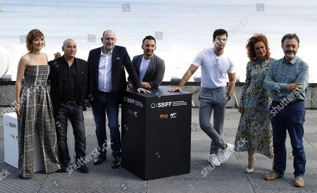 Alejandro Amenabar (C) poses next to cast actors Eduard Fernandez (2-L), Karra Elejalde (3-L), Nathalie Poza (L), Santi Prego (R), Patricia Lopez-Arnaiz (2-R) and Carlos Serrano (3-R) during the presentation of the film 'Mientras Dure la Guerra' (lit. as long as the war lasts) at the 67th San Sebastian International Film Festival (SSIFF), in San Sebastian, Spain, 21 September 2019. The festival runs from 20 to 28 September.
