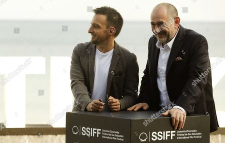 Alejandro Amenabar (L) poses next to cast actor Karra Elejalde (R) during the presentation of the film 'Mientras Dure la Guerra' (lit. as long as the war lasts) at the 67th San Sebastian International Film Festival (SSIFF), in San Sebastian, Spain, 21 September 2019. The festival runs from 20 to 28 September.