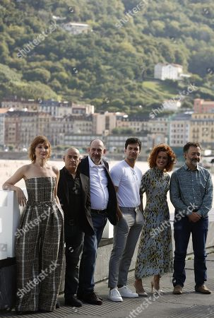 Alejandro Amenabar (C) poses next to cast actors Eduard Fernandez (2-L), Karra Elejalde (3-L), Nathalie Poza (L), Santi Prego (R), Patricia Lopez-Arnaiz (2-R) and Carlos Serrano (3-R) during the presentation of the film 'Mientras Dure la Guerra' (lit. as long as the war lasts)at the 67th San Sebastian International Film Festival (SSIFF), in San Sebastian, Spain, 21 September 2019. The festival runs from 20 to 28 September.