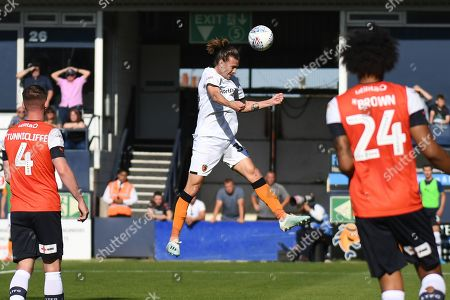 Hull City midfielder Jackson Irvine (36) heads the ball  at goal during the EFL Sky Bet Championship match between Luton Town and Hull City at Kenilworth Road, Luton