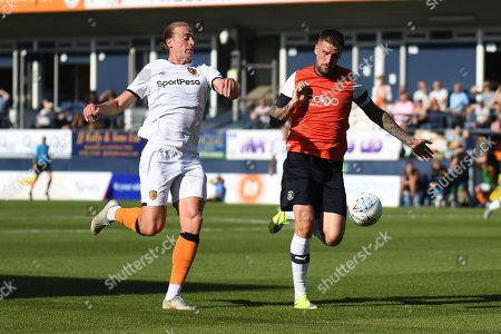 Hull City midfielder Jackson Irvine (36) battles for possession  with Luton Town defender Sonny Bradley (5) during the EFL Sky Bet Championship match between Luton Town and Hull City at Kenilworth Road, Luton