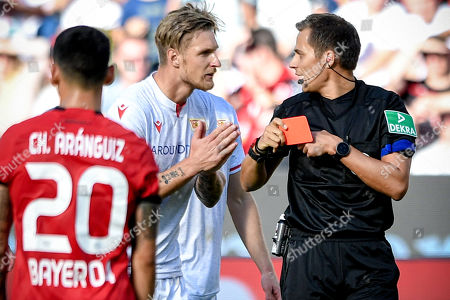 Union's Sebastian Polter (C) is booked red card by referee Robert Hartmann (R) during the German Bundesliga soccer match between Bayer Leverkusen and 1. FC Union Berlin in Leverkusen, Germany, 21 September 2019.