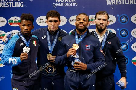 From left, silver medalist Frank Chamizo Marquez of Italy, gold medalist Zaurbek Sidakov of Russia, bronze medalist Jordan Ernest Burroughs of United States, and bronze medalist Zelimkhan Khadjiev of France pose for a photo during a medal ceremony at the men's 74kg category during the Wrestling World Championships in Nur-Sultan, Kazakhstan