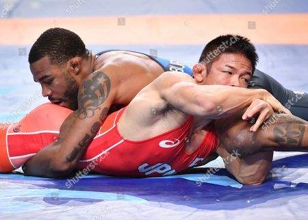 Stock Image of United States' Jordan Ernest Burroughs, right, and Japan's Mao Okui, in red, compete at the bronze match of the men's 74kg category during the Wrestling World Championships in Nur-Sultan, Kazakhstan