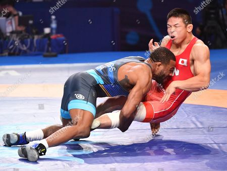 Stock Picture of United States' Jordan Ernest Burroughs, left, and Japan's Mao Okui compete at the bronze match of the men's 74kg category during the Wrestling World Championships in Nur-Sultan, Kazakhstan