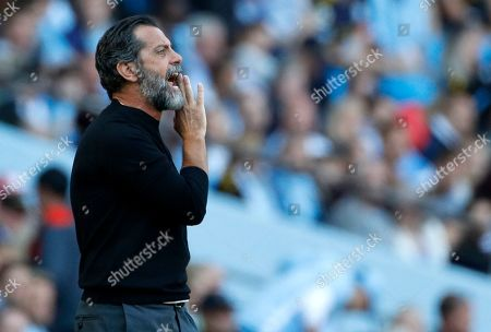 Stock Image of Watford's head coach Quique Sanchez Flores shouts during the English Premier League soccer match between Manchester City and Watford at Etihad stadium in Manchester, England
