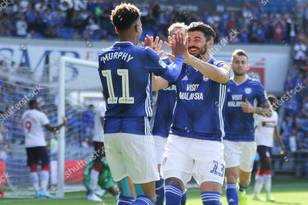 Stock Photo of Callum Paterson of Cardiff City celebrates with corner taker Josh Murphy of Cardiff City after Ashley Fletcher of Middlesbrough heads the ball into his own net from the corner to score an own goal