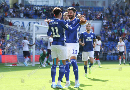 Callum Paterson of Cardiff City celebrates with corner taker Josh Murphy of Cardiff City after Ashley Fletcher of Middlesbrough heads the ball into his own net from the corner to score an own goal