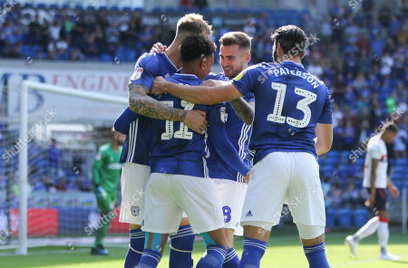 Cardiff City players celebrate with corner taker Josh Murphy of Cardiff City after Ashley Fletcher of Middlesbrough heads the ball into his own net from the corner to score an own goal
