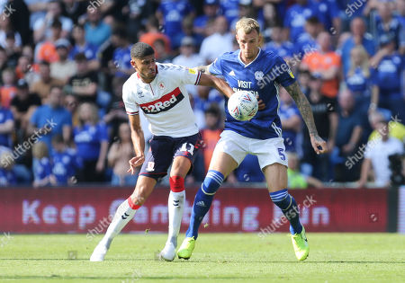 Aden Flint of Cardiff City and Ashley Fletcher of Middlesbrough compete for the ball