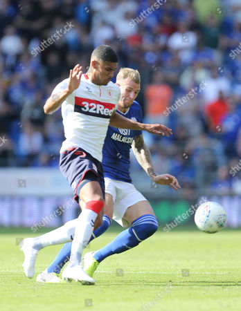 Stock Image of Ashley Fletcher of Middlesbrough is challenged by Aden Flint of Cardiff City