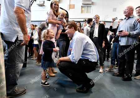 Democratic U.S. Rep. Joseph Kennedy III, D-Mass., speaks to a young supporter as he arrives with his wife Lauren Kennedy, and son James Kennedy, 1, in East Boston to announce his candidacy for the Senate, in Boston. Kennedy will challenge incumbent Sen. Ed Markey in the Democratic primary