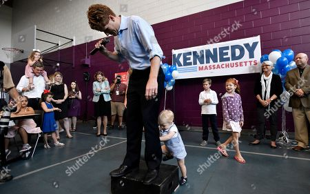 Democratic U.S. Rep. Joseph Kennedy III, D-Mass., reacts as his son James Kennedy, 1, attempts to climb onto the podium as he announces his candidacy for the Senate, in Boston. Kennedy will challenge incumbent Sen. Ed Markey in the Democratic primary