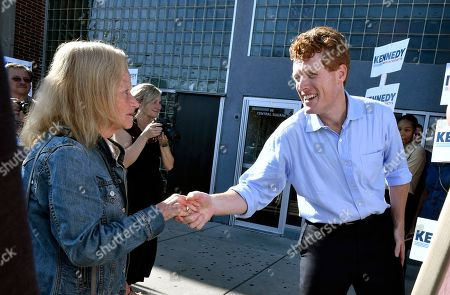 Democratic U.S. Rep. Joseph Kennedy III, D-Mass., right, greets a supporter in East Boston after announcing his candidacy for the Senate, in Boston. Kennedy will challenge incumbent Sen. Ed Markey in the Democratic primary