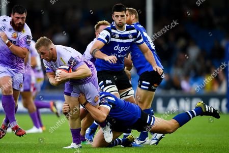 Billy Keast of Exeter Chiefs is challenged by Sam Nixon of Bath Rugby