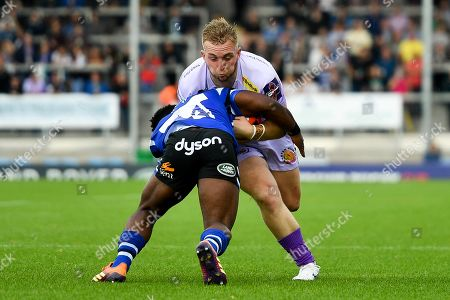 Stock Picture of Billy Keast of Exeter Chiefs is tackled by Levi Davis of Bath Rugby