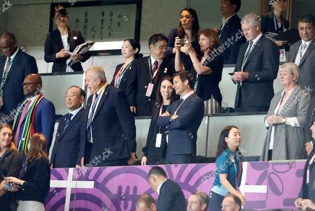 New Zealand Prime Minister Jacinda Ardern, center, stands with her partner Clarke Gayford, center right, and World Rugby Chairman Bill Beaumont, left, watch the Rugby World Cup Pool B game at International Stadium between New Zealand and South Africa in Yokohama, Japan
