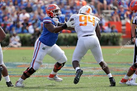 Stock Image of Florida offensive lineman Richard Gouraige, left, blocks Tennessee defensive lineman Matthew Butler (94) during the second half of an NCAA college football game, in Gainesville, Fla