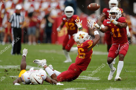 Iowa State defensive back Lawrence White, right, intercepts a pass intend for Louisiana-Monroe wide receiver Zach Jackson, left, after Iowa State defensive back Anthony Johnson, center, tipped the ball during the first half of an NCAA college football game, in Ames