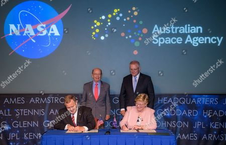 U.S. Secretary of Commerce Wilbur Ross, top left, and Australian Prime Minister Scott Morrison, top right, witness the signing of a letter of intent between NASA and the Australian Space Agency by NASA Deputy Administrator Jim Morhard, left, and Dr. Megan Clark, Head of the Australian Space Agency, right, at NASA Headquarters in Washington. NASA and the Australian Space Agency will build on over 60 years of collaboration in space exploration between the two countries and commit to expanding cooperation