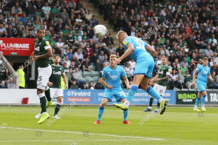 Luke Varney heads in the opening goal of the game and celebrates with his team mates  during the EFL Sky Bet League 2 match between Plymouth Argyle and Cheltenham Town at Home Park, Plymouth